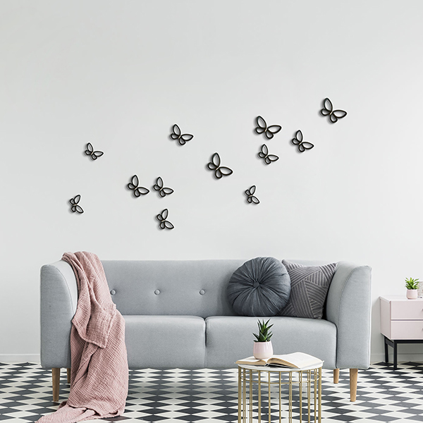 Pink blanket and pillows on grey couch in white living room inte